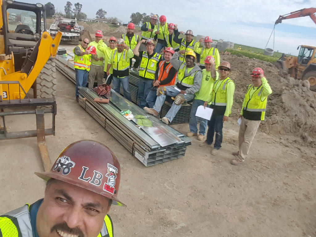 An image of the construction team at a site posing together