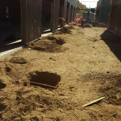 An image of a building's yard being prepped for construction